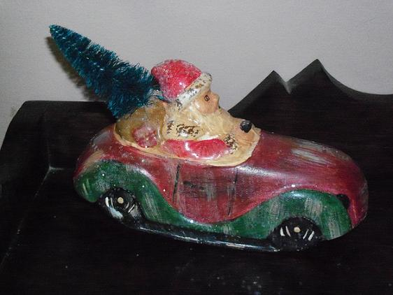 santa driving car with tree